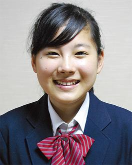 受賞に笑顔を見せる石川さん