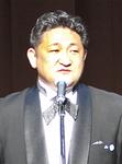 挨拶に立つ串田青年部会長