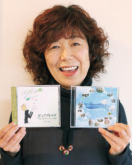 復興応援CDを持つ木村さん