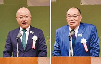 式典であいさつに立つ塚田委員長(右)と小野崎区長