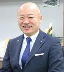 本紙のインタビューに答える小野崎区長