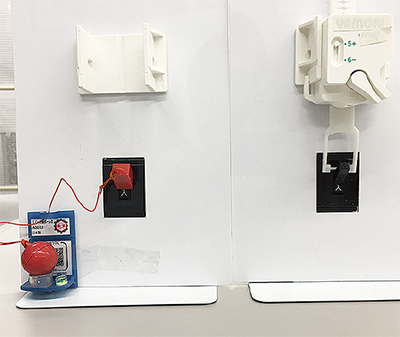 おもり玉式(左)とバネ式の感震ブレーカー