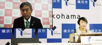Web会議で行われた開通式で意見を交わす林文子市長(右)と山本町長