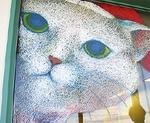窓ガラスに描かれた猫の絵