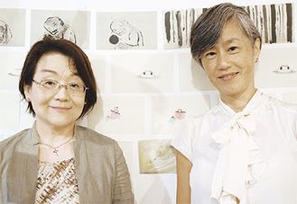 イラストの前に並ぶ水谷理事長(左)と牧田さん