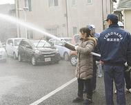 事業所と協力し消火訓練