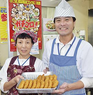 銀賞に笑顔の村井さん夫妻