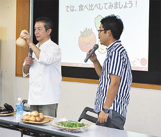 区内で収穫した野菜を紹介する椿さん(左)と横山さん