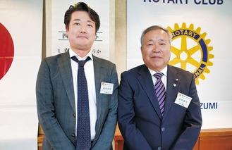 高梨会長(右)と次年度会長に決まった飯田氏