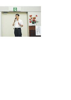 講演する菊池英彌会長