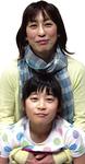 笑顔の田中さん親子