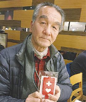 普及活動を行う戸塚在住の福崎さん