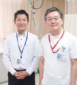 戸塚共立第2病院の饗場院長(右)と木村事務長