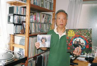 松田聖子とローリングストーンズのレコードを持つ堀口さん