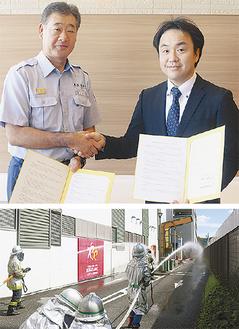 握手を交わす名取署長(左)と中曽根支配人(写真上)実施された放水訓練