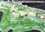 同団体の手作りの完成予定模型。中央の草広場を中心にどろんこの庭、雨だれデッキ、かまど、林間デッキなどを作る予定。