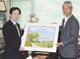 同会の斉藤さんから鯉渕局長に絵画贈呈