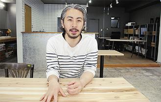 コミュニティスペースへの思いを話す永田代表
