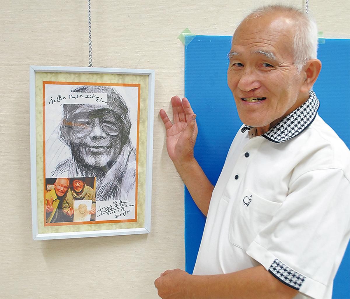 一番のお気に入りだという大林宣彦監督の似顔絵と河田さん