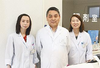 代表の川田さん(中央)とスタッフ