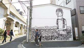 街中に出現する壁画アート(主催者提供)