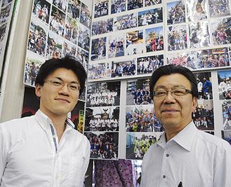 安居幹男さん(右)・卓実さん親子。店内には動画も流れる