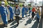 鶴見消防団第八分団の指導のもと行われた放水訓練