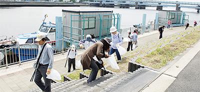 キリンが鶴見川清掃