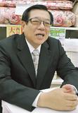 取材に応じる石川会長