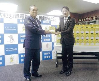 二宮会長(右)と日下部署長