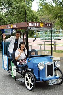 自転車タクシーを体験した中原区在住の福永親子(手前)