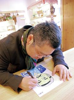 創作活動に集中する黒沢さん