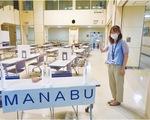 「MANABU」の会場をPRする区職員
