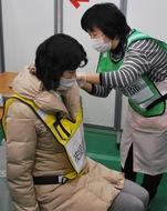全国初、国とコロナワクチン集団接種訓練