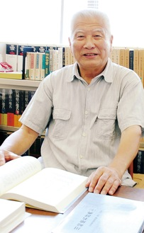 取材に応える菊地事務局長