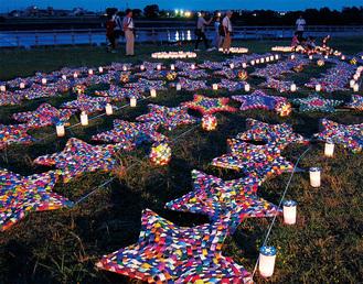 「多摩川キャンドルナイト灯と人」の協力で点灯