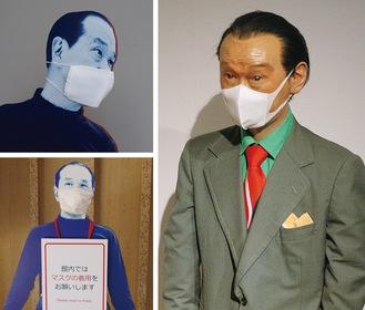 マスクをつけて来館者を迎える岡本氏の展示