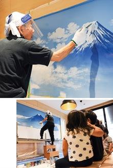 富士山を描く丸山さん(上)。創作を見つめる園児たち