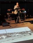 オカリナ演奏と、被災地の写真投影