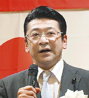 県政報告する川本氏