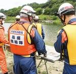 多摩川を挟み合同訓練