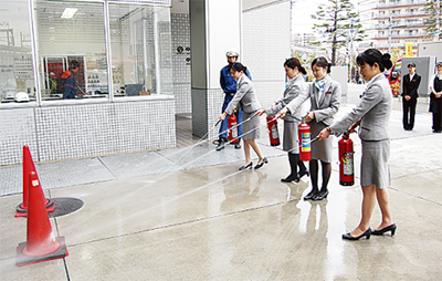 消防訓練で連携深める