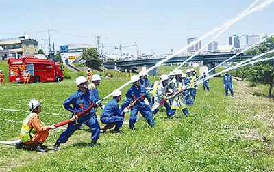 水害備え多摩川で訓練