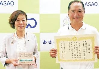 三瓶区長(左)と木村社長=提供