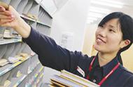 郵便局で仕分け・組立作業
