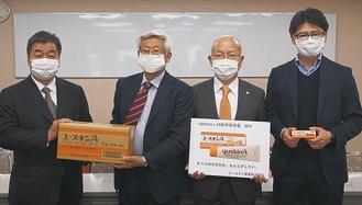 野渡社長(中央右)と近藤理事長(中央左)
