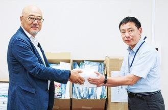 成田事務局長(左)と小澤部長