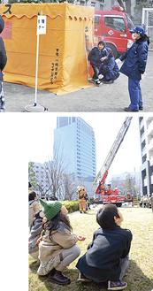 中学校校庭で煙体験を実施(上)はしご車での救助を見守る子どもたち(下)