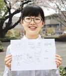 手帳をデザインした長岡翠さん。下書きを手に=4月1日撮影