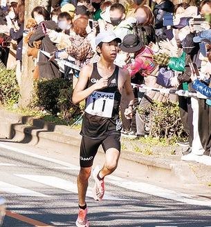 ▲福岡の町を力走する吉田選手